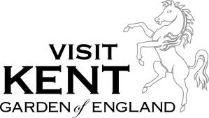 Visit Kent Logo- Visit Kent Garden of England written in black on a white background, a white horse to the right