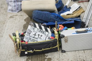 Behind the scenes of The Tunnel Sabotage - a kit bag on the floor with clapperboard in
