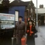Michele Dotrice as Betty and Michael Crawford as Frank Spencer walking out of a train station