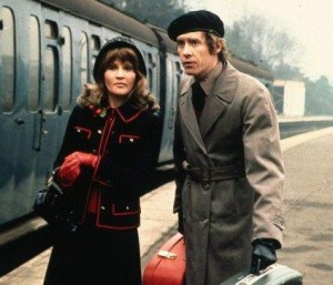 Michele Dotrice as Betty and Michael Crawford as Frank Spencer standing in front of a train