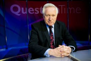 Question Time David Dimbleby sitting in front of a desk