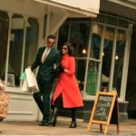 Two actors shopping outside a shop in canterbury,