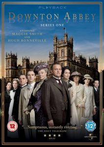 Downton Abbey series 1 DVD cover - the cast standing in front of the grand house. Downton Abbey is written on top