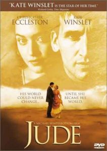 Jude film poster- faint image of Kate Winslet and Christopher Eccleston's faces as a backdrop- underneath the two characters are dancing the the sand. JUDE written in yellow