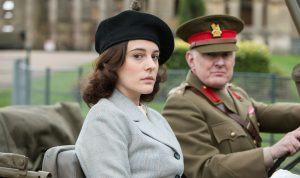 Kathy Griffiths (PHOEBE FOX) and Brigadier Wainwright (ROBERT GLENISTER) sitting in a car facing the camera