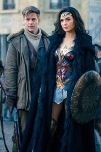 Captain Steve Trevor (Chris Pine) and Wonder Woman (Gal Gadot) standing next to each other facing the camera