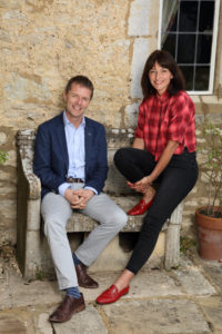 Davina McCall and Nicky Campbell sitting on chair looking at camera
