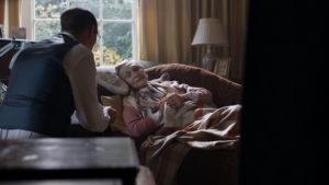 Lady Bristow (SIAN PHILLIPS) lying on sofa talking to John Bristow (LEO BILL),