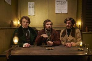 Three Quack characters sitting at bar table looking at camera