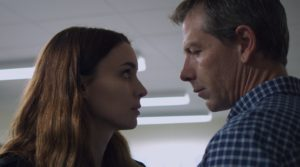 Una (Rooney Mara) and Ray (Ben Mendelsohn) staring at each other