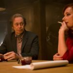 Jill (Sidse Babett Knudsen) and Ed (Steve Buscemi) sitting at a table.