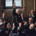 Gary Oldman in his role as Chrurchill giving the Victory sign in parliament in the film the Darkest Hour (2017)