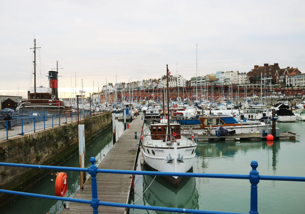 The photograph shows Ramsgate Marina with small boats harboured