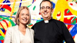 Image of presenters Mariella Frostrup and Rev. Richard Coles in front of a multicoloured painted background.