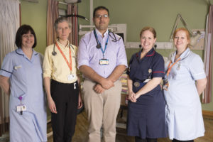 5 Featured Staff from the Hospice- Two doctors in the middle with two nurses to their right and another nurse to the left.