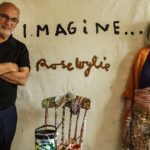 Artist Rose Wylie and presenter Alan Yentob pictured standing together in Rose's home