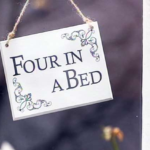 Four in a bed series logo on a white sign