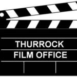 Image of black and white clapper board with the words thurrock film office written in white in the middle. Links to their website.