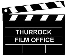 Image of clapper board with the words thurrock film office written in white in the middle.