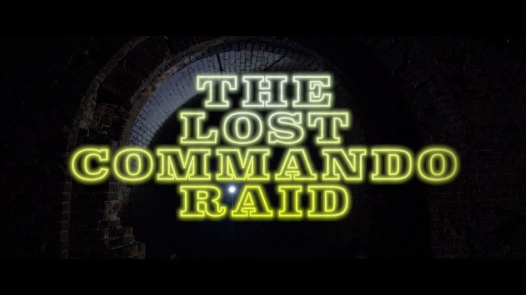 Image of a dark tunnel with The Lost Commando Raid text over the top in bright yellow.