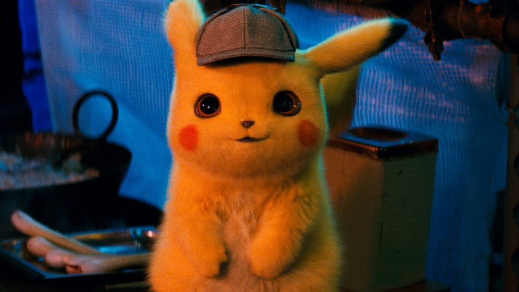 Animated yellow Detective Pikachu seen smiling at the camera wearing a cap. Utensils and pipes in the background.