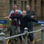 Gavin (Jason Watkins) and his friends seen running and struggling at Dublin Ferry Port.
