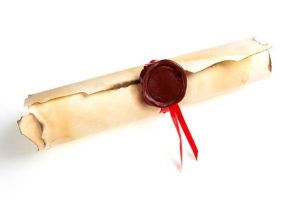 Old fashioned parchment scroll with a red wax seal in the middle.