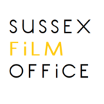 Sussex Film Office logo- black writing reading Sussex Office on a white background with film written in yellow in between. Links to their website.