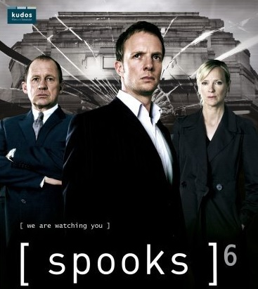 Actors Peter Firth, Hermione Norris and Rupert Penry-Jones wearing dark suits staring into the camera with a cracked glass effect behind them.