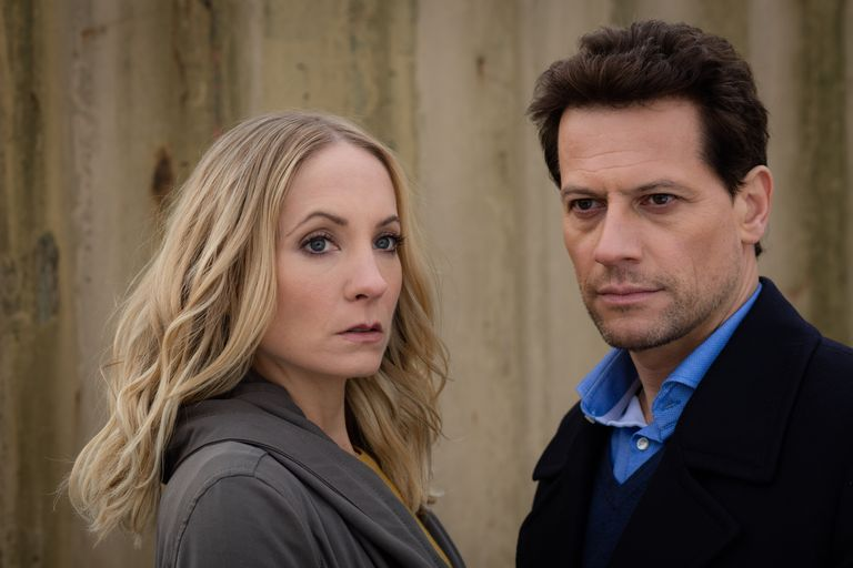 Actors Joanne Froggatt and Ioan Gruffudd standing in front of a building