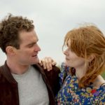 Mark Stanley (David Tait) and Emily Beecham (Vanessa Tait) looking at each other in Sulphur and White (2020)