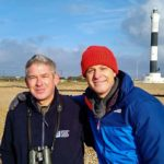 Owen Leyshon from Romney Marsh Countryside Partnership and presenter Matt Baker on the pebbled beach in front of the New Dungeness Lighthouse