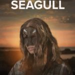 Movie poster of Seagull showing a woman wearing a mask against a sunset beach scene