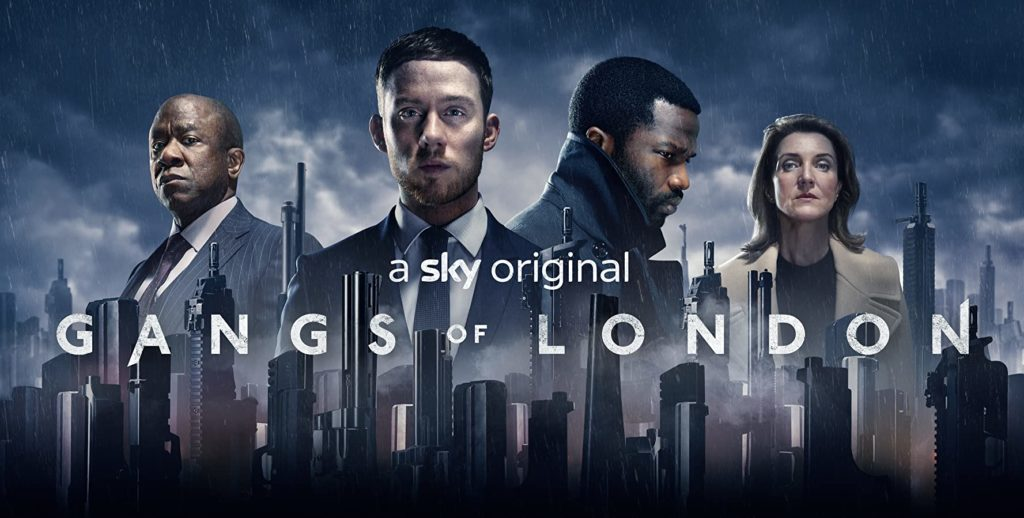 Production poster showing the London skyline and four actors in suits above it in the rainy clouds. Sky Original Gangs of London written in white