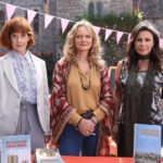 Cast Julie Graham, Siobhan Redmond, and Sarah Woodward standing outside a church