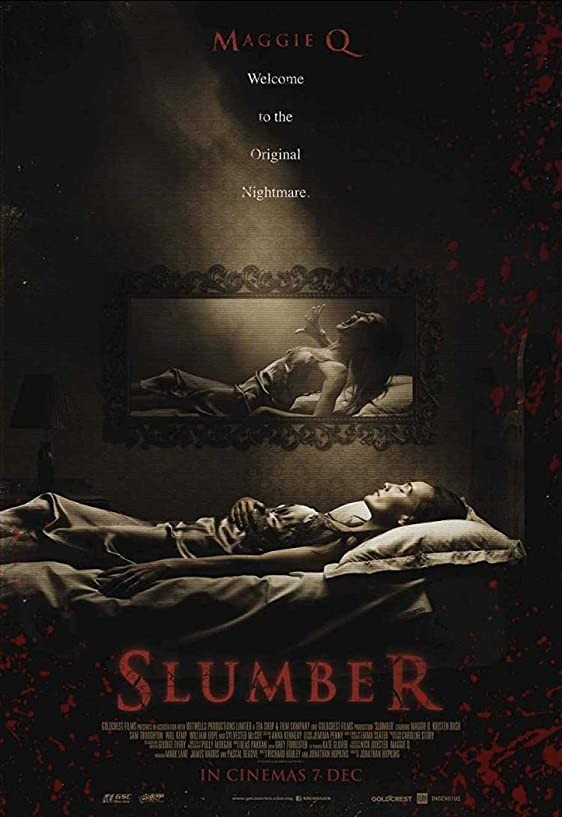 Slumber Film Poster- actress Maggie Q lying asleep wearing a night dress in a dark room on a bed, above her on the wall is a mirror which shows her in the same position but this time screaming. Slumber written in red underneath image