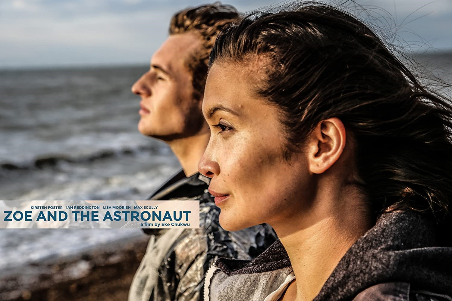 Zoe and the Astronaut Film poster depicting close up, side profile shot of a Max Scully as the Astronaut and Kirsten Foster as Zoe looking out to sea. Zoe and the astronaut reads in blue in the centre
