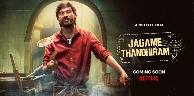 Actor Dhanush with brown hair and a beard is shown flipping a pancake in a kitchen, wearing a red shirt. The movie title Jagame Thandhiram and 'coming soon' Netflix is printed on a black background to the right of the actor.
